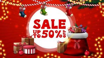 Christmas sale, up to 50 off, red discount banner for website with Christmas stockings and Santa Claus bag with presents