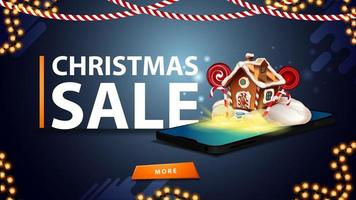 Christmas sale, blue discount banner for website with garlands, button and smartphone from the screen which appear Christmas gingerbread house