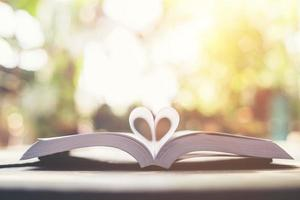 Heart-shaped book page photo