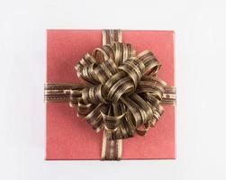 Gift box with a bow isolated on white background