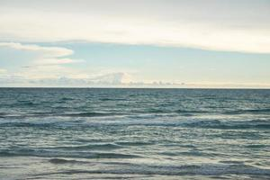 Blue ocean with sky background photo