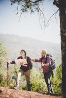 Backpackers couple hiking outdoors