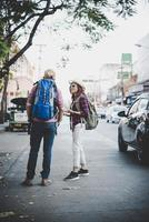 Travel couple walking around city on vacation