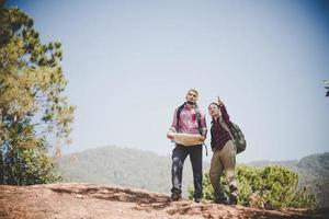 Young tourist couple hiking to a mountain