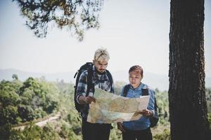 Young adventure couple hiking to a mountain