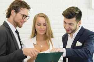 Group of young business co-workers discuss work