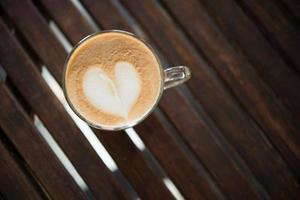 Close-up of cappuccino cup with heart shaped milk pattern