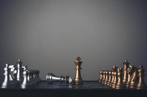 King and knight chess setup on dark background photo