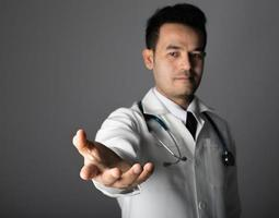 Medical doctor with a stethoscope and empty hand