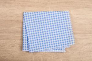 Blue table napkins isolated on white background photo