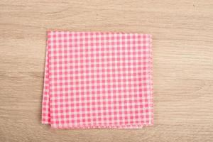Red table napkin isolated on background