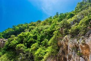 Mountain and blue sky at Koh Kham island in Thailand photo