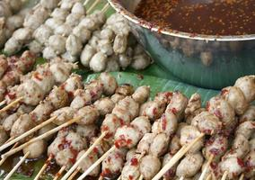 Pork on sticks with dipping sauce