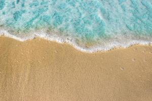 Ocean waves and foam on beach