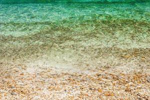 Ocean waves on pebbles at beach