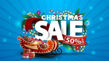 Christmas sale, blue discount banner with 3D text decorated of Christmas tree branches, candies and garlands.