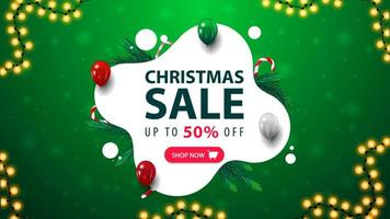 Christmas sale, green and white discount banner in liquid abstract shape with balloons, candy canes, garland and button