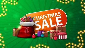 Christmas sale, green and orange discount web banner with Santa Claus bag with presents