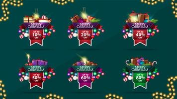 Collection of Christmas discount stickers made of ribbons and decorated with pile of Christmas presents