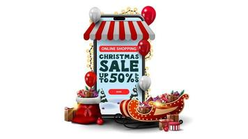 Online shopping, Christmas Sale, up to 50 off. Online shopping with smartphone. Volumetric smartphone wrapped with garland and presents isolated on white background