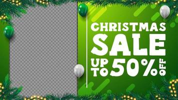 Green Christmas discount blank template for your creativity with frame of Christmas tree branches, garland, copy space and flying balloons