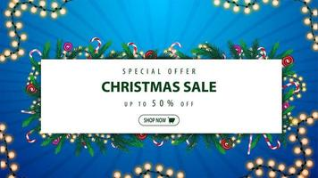 Special offer, Christmas sale, up to 50 off, blue and white discount banner with frame of Christmas tree branches and garlands around a white rectangle with offer and button