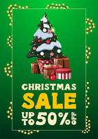 Christmas sale, up to 50 off, green vertical discount banner in minimalistic style with garland frame and Christmas tree and gifts