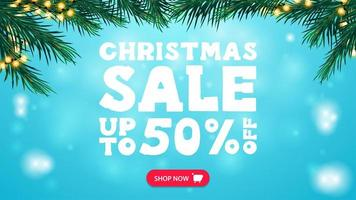 Christmas sale, up to 50 off, blue discount banner with frame of Christmas tree branches decorated with garland, button and large white offer