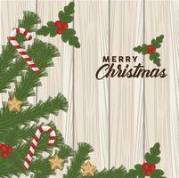 Feliz navidad letras con bastones y hojas en fondo de madera vector