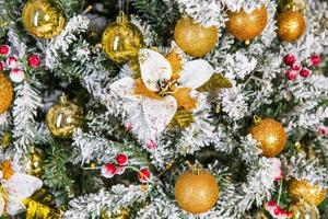 Close-up decorated Christmas tree with golden ornaments photo