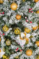 Close-up of decorated Christmas tree with golden ornaments photo
