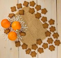 Tangerines with gingerbread cookies photo