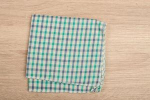Green table napkins isolated on white background