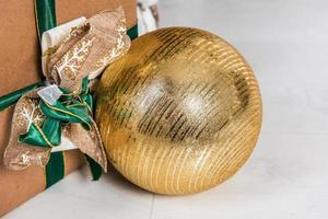 Close-up of Christmas ornament and gift