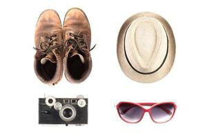 Tourism mock up of vintage camera, hat, shoes and sunglasses photo