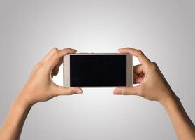 Woman hand holding smart phone blank screen photo