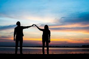 Silhouette of young couple during sunset photo