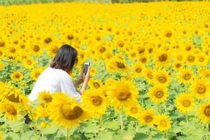 Asian woman on the sunflower field