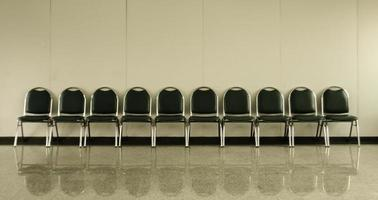 Chairs in empty waiting room photo