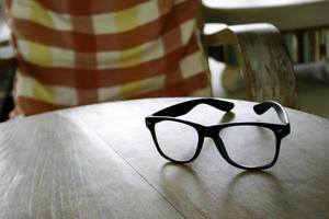 Pair of glasses on table