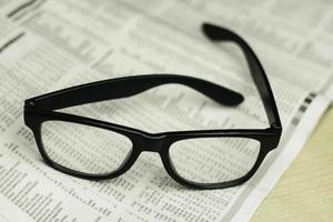 Glasses on newspaper photo