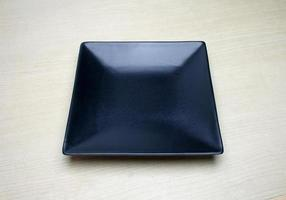 Square black plate on table