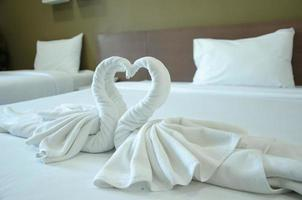 Swan towels on bed