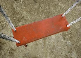Red wood swing photo