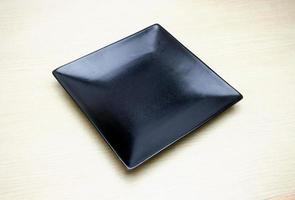 Black square plate on table