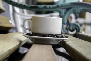 Coffee mug on bench