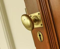 Brass doorknob on door photo