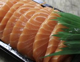 Salmon sashimi on plate photo