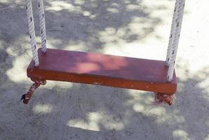 Old red swing photo