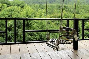 Outdoor swing on deck photo